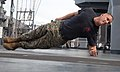 U.S. Marine Corps Sgt. Jonathan Benezette demonstrates the left plank position during Marine Corps martial arts training aboard the dock landing ship USS Oak Hill (LSD 51) during Amphibious-Southern Partnership 111009-A-WF228-011.jpg