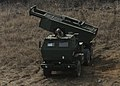 U.S. Marines with Delta Battery, 2nd Battalion, 14th Marine Regiment, III Marine Expeditionary Force set up a High Mobility Artillery Rocket System during a live-fire scenario March 27, 2014, at Rodriguez Range 140327-M-GZ082-021.jpg
