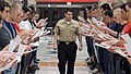 U.S. Navy Machinist's Mate 1st Class Eric Gonzalez, center, a recruit division commander, welcomes recruits during Night of Arrival inside the Golden 13 Recruit Inprocessing Center at Recruit Training Command 121120-N-IK959-579.jpg