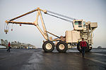 U.S. Sailors assigned to the crash and salvage team aboard the aircraft carrier USS Harry S. Truman (CVN 75) move the ship's mobile salvage crane on the flight deck March 9, 2014, in the Gulf of Oman 140309-N-GH675-002.jpg