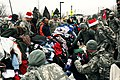 U.S. Soldiers with the 1st Brigade Combat Team, 4th Infantry Division set up piles of donated clothes and food for residents in Colorado Springs, Colo., as part of Operation Happy Holidays Dec. 2, 2011 111202-A-QF214-162.jpg