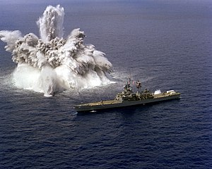 USS Arkansas (CGN-41) - An explosive charge is detonated off the starboard side of the nuclear-powered guided missile cruiser USS Arkansas during a shock test, 17 March 1982