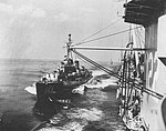 USS Basilone (DDE-824) approaches USS Palau (CVE-122), in 1952.jpg