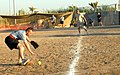 US Army 51601 BAGHDAD - Sgt. John Horton, an air movement request non-commissioned officer from Zephyr Hills, Fla., makes a play in the outfield, Sept. 24, as part of a Hispanic Heritage Month softball tournament.jpg