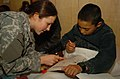 US M.P. and a young Afghan patient play with crayons at the Egyptian Hospital, Bagram..jpg