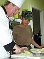 US Navy 020619-N-1485H-001 Mess Specialist 3rd Class Esmeralda Prestosa from Mililani, HI, learns sushi preparation techniques from Master Chef Randy Green.jpg