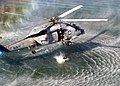 "US Navy 021004-N-8629M-002 A Search and Rescue (SAR) swimmer prepares to jump from an SH-60B ""Seahawk"" helicopter.jpg"