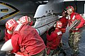 US Navy 030310-N-5786V-502 Ordnancemen mount a training version of the RIM-7.jpg