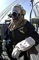 US Navy 030310-N-8273J-002 Manning the port lookout station, Seaman Sue Young wears a MCU-2-P gas mask during a simulated chemical, biological and radiological (CBR) warfare attack.jpg