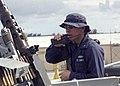 US Navy 030417-N-9392E-001 Storekeeper 3rd Class Pedro Gonzales from San Antonio, Texas, makes a report via hand-held radio.jpg
