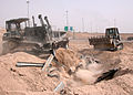 US Navy 040504-N-1261P-011 U.S. Navy Seabees assigned to Naval Mobile Construction Battalion Seven Four (NMCB-74) help clean up a section of highway near Fallujah, Iraq.jpg