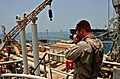 US Navy 040517-N-9885M-018 Photographer's Mate 2nd Class Joseph Tepas, assigned to Combat Camera Group Pacific, documents the offloading of equipment onto the Al Basrah Oil Terminal (ABOT).jpg