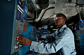 US Navy 040606-N-6213R-043 Ship's Serviceman 3rd Class Calvin Martin of Houston, Tex. activates a washing machine in the ships laundry aboard USS John C. Stennis (CVN 74).jpg