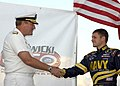 US Navy 040626-N-5576W-017 Vice Commander, Space and Naval Warfare Systems Command, Rear Adm. Michael A. Sharp shakes the hand of the Navy sponsored No. 14 Chevy Monte Carlo NASCAR driver Casey Atwood.jpg