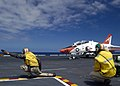 US Navy 040821-N-4748O-089 Lt.Cmdr. Jake Jacoby and Lt. Mark Sibon gives the go to a T-45A Goshawk assigned to Training Air Wing Two (TW-2) to launch from catapult one.jpg