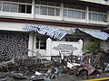 US Navy 050101-O-XXXXB-086 Trash and debris line the streets near a local building in down town Aceh, Sumatra following a massive Tsunami that struck the area on the 26th of December 2004.jpg