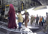 US Navy 050105-N-5376G-004 Australian Military personnel help Tsunami victims board a C-130 Hercules aircraft prior to being flown from Sultan Iskandar Muda Air Force Base in Banda Aceh, Indonesia to Jakarta, Indonesia.jpg