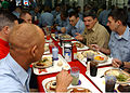 US Navy 050114-N-5345W-117 Master Chief Petty Officer of the Navy Terry Scott talks with Sailors during lunch.jpg