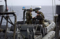 US Navy 050421-N-4309A-067 Sailors assigned to Special Boat Team Twelve mount a .50 caliber machine gun aboard their Mark V Rigid Hull Inflatable Boat while underway with the amphibious transport dock USS Duluth (LPD 6).jpg