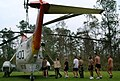 US Navy 050901-N-8047K-128 U.S. Navy Sailors and civilian personnel unload food and water from a UH-3H Sea King helicopter, transported from Naval Air Station Pensacola, Fla., to provide support and relief to victims of Hurrica.jpg
