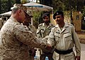 US Navy 051107-N-1261P-042 A U.S. Marine shakes the hand of a Pakistani official during a walking tour of Muzafarrabad, Pakistan.jpg
