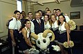 US Navy 051130-N-2568S-004 Secretary of Defense Donald Rumsfeld poses for a photograph with the U.S. Naval Academy cheerleader squad during a Pep-Rally.jpg