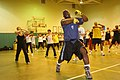 US Navy 060411-N-6270R-003 Tae Bo creator, Billy Blanks holds a class for service members and their dependents on his famous roll boxing Tae Bo techniques.jpg