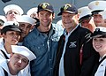 US Navy 060524-N-7292N-139 Actors Hugh Jackman and Kelsey Grammer, are surrounded by Sailors on the flight deck aboard the amphibious assault ship USS Kearsarge (LHD 3), during opening day for Fleet week New York City 2006.jpg