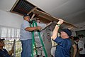 US Navy 070213-N-6997B-009 Senior Chief Operations Specialist David Nusbaum and Operations Specialist 1st Class Amy Williams make ceiling repairs during a community service project at Cebu's Lo-Ok High School.jpg