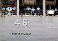 US Navy 070724-N-6295H-001 Sailors aboard dock landing ship USS Tortuga (LSD 46) watch as the ship prepares to moor in Sasebo after completing a two-month deployment, which included participation in Talisman Saber 2007.jpg