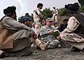 US Navy 070909-N-3385W-033 Cmdr. Dave Adams, commanding officer of Provincial Reconstruction Team Khost, holds an impromptu shura with village elders to discuss recent attacks on a local municipal building.jpg