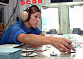 US Navy 071027-N-1287L-063 Aviation Boatswain's Mate (Handling) Airman Sarah McMillen places jet models in their respective positions on a scaled version of the flight deck aboard nuclear-powered aircraft carrier USS Enterprise.jpg