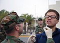 US Navy 071107-N-0775Y-005 Hospital Corpsman Chief Robert Bott administers a flu mist nasal spray vaccine to Utilitiesman 3rd Class Anthony Mezlak during a battalion-wide immunization day at Port Hueneme.jpg
