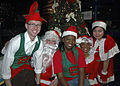 US Navy 071205-N-1512O-100 Members of the Morale Welfare and Recreation (MWR) committee aboard the multi-purpose amphibious assault USS Bataan (LHD 5) bring Santa, Mrs. Claus and their elves to life at the command's children's.jpg