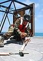 US Navy 080630-N-4973M-009 Seaman Rafael Garcia, assigned to Amphibious Construction Battalion (ACB) 1, secures a structural piece of the Navy Elevated Causeway System (ELCAS).jpg