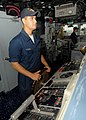 US Navy 080711-N-4236E-018 Seaman Allen Parces steers the guided-missile cruiser USS Vella Gulf (CG 72) during the Iwo Jima Expeditionary Strike Group composite unit training exercise.jpg