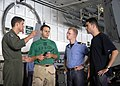US Navy 080723-N-6676S-061 Chief Aviation Electrician's Mate Robert Colonna, center, and Aviation Machinist's Mate 3rd Class Josh Elmore, left, discuss the morning agenda.jpg