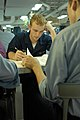 US Navy 080919-N-7730P-029 Air Traffic Controller Airman Robert Hoth concentrates on his exam during the Navy-wide E-4 advancement exam aboard the Nimitz-class aircraft carrier USS Ronald Reagan (CVN 76).jpg