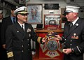 US Navy 081013-N-1003P-026 Capt. James Boorujy presents Lt. John Cullen a Nassau commanding officer ball cap.jpg