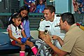 US Navy 081106-N-8390S-083 Lt. Andrew Baldwin, M.D., assigned to the Navy Bureau of Medicine and Surgery, visits children and passes out Navy teddy bears at the Shriners Hospital.jpg