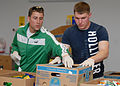 US Navy 090420-N-1522S-005 Cryptologic Technician (Repairman) 2nd Class Richard Swank and Information Systems Technician Seaman Michael Cunningham take some time out of their liberty to volunteer at the Lowcountry Food Bank.jpg