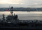 US Navy 090819-N-7047S-093 The aircraft carrier USS George Washington (CVN 73) transits Manado Bay during the Indonesia International Fleet Review, which commemorates the 64th anniversary of Indonesian independence.jpg