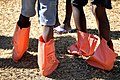 US Navy 100121-D-1852B-642 Children use plastic bags from humanitarian meals as boots at an earthquake survivor camp in Port-au-Prince, Haiti.jpg