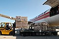 US Navy 100125-N-9402B-001 Paul Reardon of Empire Cargo loads pallets of food and humanitarian supplies onto a transport aircraft for shipment to Naval Station Guantanamo Bay, Cuba.jpg