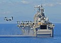 US Navy 100129-N-1082Z-028 A MV-22B Osprey assigned to Marine Medium Tiltrotor Squadron (VMM) 162, prepares to land aboard the multi-purpose amphibious assault ship USS Nassau (LHA 4) near the coast of Haiti.jpg