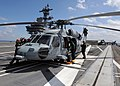US Navy 100303-N-3885H-020 Crewmen prepare an MH-60S Sea Hawk helicopter for flight operations.jpg