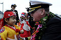 US Navy 100305-N-7478G-337 Capt. Rudy Lupton, commanding officer of the U.S. 7th Fleet command ship USS Blue Ridge (LCC 19), greets Jeon Ye Som, daughter of a Republic of Korea naval officer.jpg