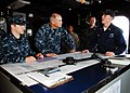 US Navy 100420-N-9706M-452 Quarter Master 2nd Class Corey T. Vyvyan speaks with Vice Adm. Richard W. Hunt, commander of U.S. 3rd Fleet, aboard the amphibious transport dock ship USS Dubuque (LPD 8).jpg