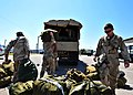 US Navy 100501-N-4267W-039 Sailors assigned to Riverine Squadron (RIVRON) 1 load equipment before departing to the Naval Station Norfolk air terminal where they will be flown to Iraq for a six-month deployment.jpg