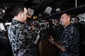 US Navy 100714-N-6477M-051 Capt. S. Robert Roth, right, commanding officer of the amphibious transport dock ship USS Cleveland (LPD 7),.jpg